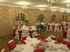 Banquet hall elegantly decorated in red table coverings for events, weddings, sweet 16, sweet sixteens, quinceaneras, baptism in Chicago Banquet Hall 3810 West 63rd St.