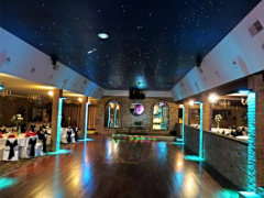Our ballroom are accented with ceiling visual display of the night and stars so it looks like there is no ceiling above big hardwood dance floor. Quinceanera,Wedding Venue in Chicago IL.