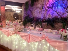 Nice banquet hall in light pink  decorations for a quinceanera party