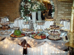 Beautifully decorated sweet table with delicious fruit and pastries in the best banquet Hall in Chicago IL