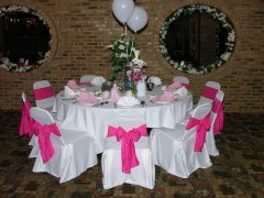 Quinceaneras Banquet Hall decoration to a birthday party in pink colors and balloons.  You choose the colors, we have a large selection of chair colors covers, napkins and ribbons